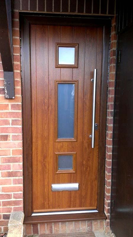Wooden look front door from Treadwell Window & Door Solutions